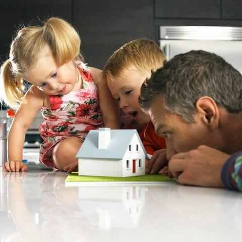 father with children looking at model home image - Headstart Homes