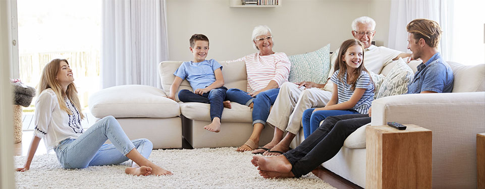 multigenerational family on couch - Multi-Generational Living – times are changing!